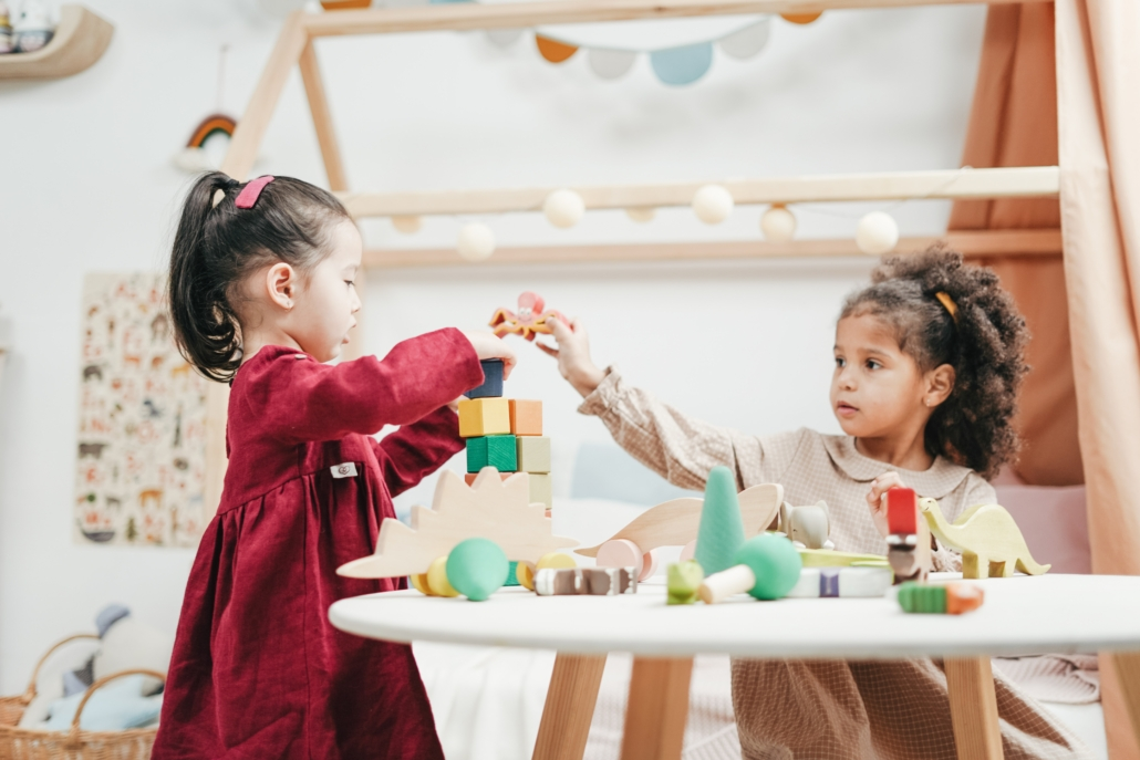 Two girls playing with the help of child care assistance