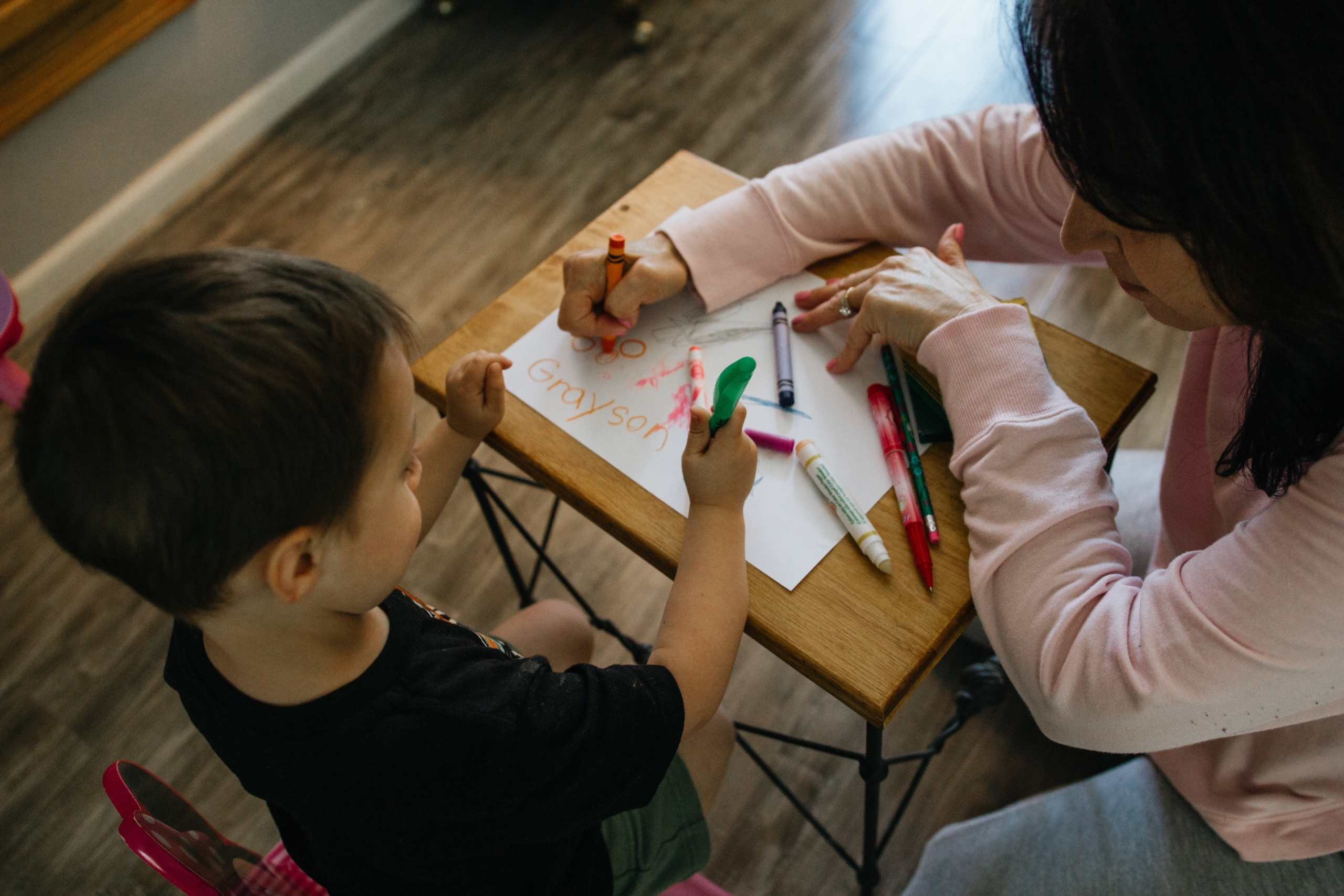 Child care provider helping a student, using her CDA certification in Missouri